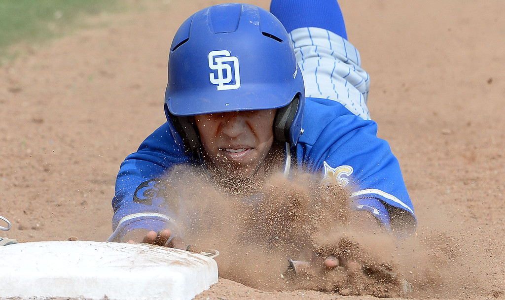 . San Dimas\' Josh Corona dives back to first base ahead of the tag in the third inning of a prep baseball game against San Dimas at Northview High School in Covina, Calif., on Wednesday, March 26, 2014. San Dimas won 2-0. (Keith Birmingham Pasadena Star-News)
