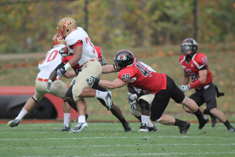Brian Wittenberger (49) reaches to pull down VMI's players