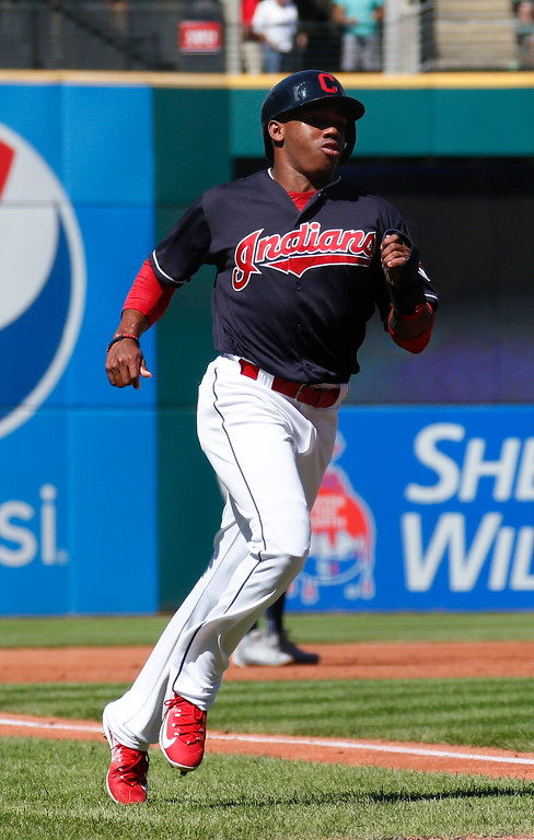 . Cleveland Indians\' Greg Allen scores on a single by Yandy Diaz off Detroit Tigers starting pitcher Francisco Liriano during the first inning of a baseball game, Sunday, Sept. 16, 2018, in Cleveland. The Tigers defeated the Indians 6-4. (AP Photo/Ron Schwane)