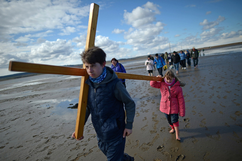 . Pilgrims walk with crosses as the Northern Cross pilgrimage makes its final leg of the journey to Holy Island on April 29, 2013 in Berwick-upon-Tweed, England. More than 50 people, young and old, celebrated Easter by crossing the tidal causeway during the annual Christian pilgrimage. Every year people of all ages, from all over the world and from all realms of Christian life walk together at Easter to Holy Island.  (Photo by Jeff J Mitchell/Getty Images)