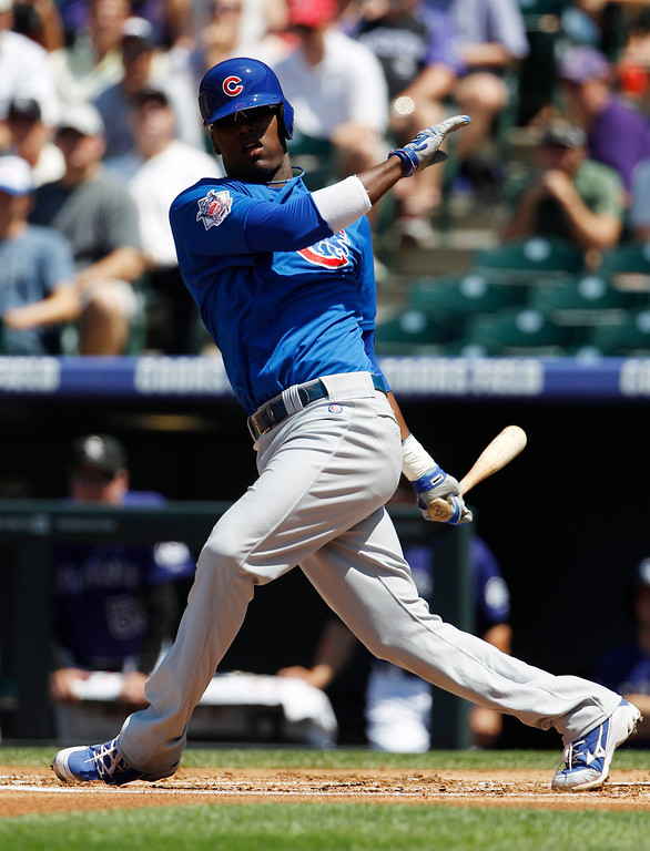 . Chicago Cubs\' Junior Lake strikes out swinging with the bases loaded against the Colorado Rockies to end the top of the first inning of a baseball game in Denver, Sunday, July 21, 2013. (AP Photo/David Zalubowski)