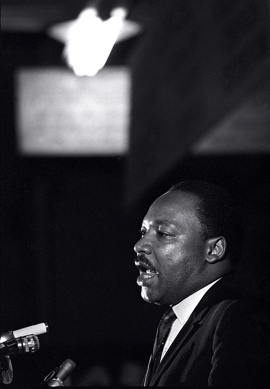 . Dr. Martin Luther King Jr. makes his last public appearance at the Mason Temple in Memphis, Tenn., on April 3, 1968.  The following day King was assassinated on his motel balcony.  (AP Photo/Charles Kelly)