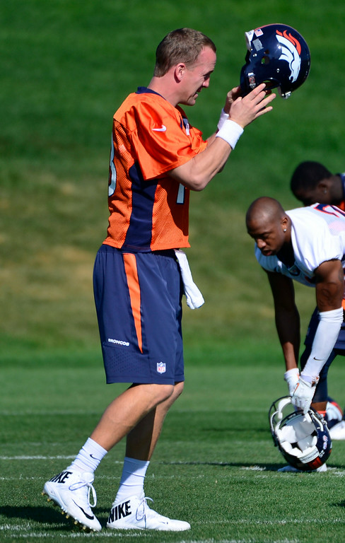 . Quarterback Peyton Manning finishes warm-ups and gets suited up for the start of practice. The Denver Broncos practice at Dove Valley on Monday, Sept. 1, 2014 in preparation for their season opener against the Indianapolis Colts on Sunday night. (Kathryn Scott Osler/The Denver Post)