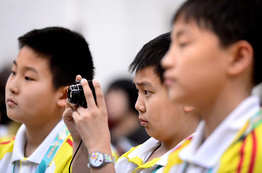 . A Chinese student from Harbin Normal University takes pictures of as Chinese students visit Immaculate Conception Catholic School in Monrovia Wednesday, January 22, 2014. (Photo by Sarah Reingewirtz/Pasadena Star-News)