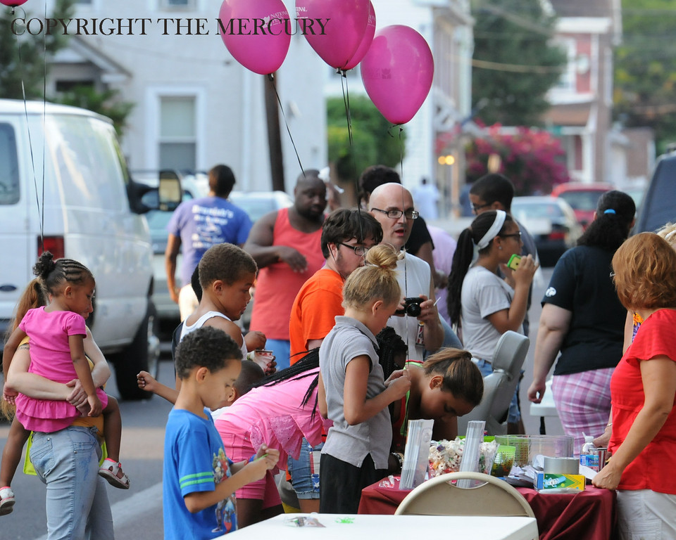 . Parents and children participate in the National Night Out event held at Chestnut Street Park sponsored by Victory Christian Life Center and Genesis Housing Inc Tuesday evening. Photo by John Strickler The Mercury