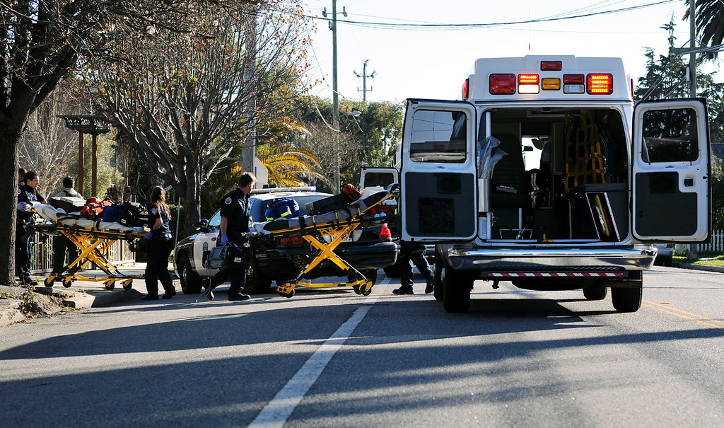 ". Paramedics arrive at the scene of a shootout that took place Tuesday afternoon near the intersection of North Branciforte Avenue and Doyle Street in Santa Cruz, Calif. <a href=""http://www.santacruzsentinel.com/localnews/ci_22674808/breaking-2-officers-1-suspect-shot-santa-cruz\"">Three people, including two police officers, were killed.</a> (Matthew Hintz/Sentinel).   that took place  that left two officers dead Tuesday afternoon"