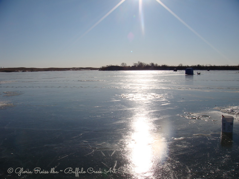 ice fishing and no snow on the lake