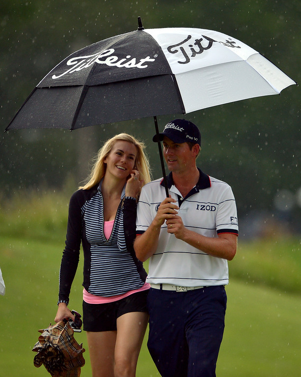 . Webb Simpson of the United States walks with his wife Dowd during Round One of the 113th U.S. Open at Merion Golf Club on June 13, 2013 in Ardmore, Pennsylvania.  (Photo by Drew Hallowell/Getty Images)