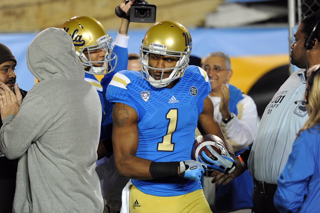 . UCLA�s Shaquelle Evans #1 reacts after scoring on a 27-yard touchdown catch during their game against Arizona State at the Rose Bowl Saturday November 23, 2013. Arizona State beat UCLA 38-33. (Photos by Hans Gutknecht/Los Angeles Daily News)
