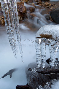 Icicles hanging over Beaver Creek, CO