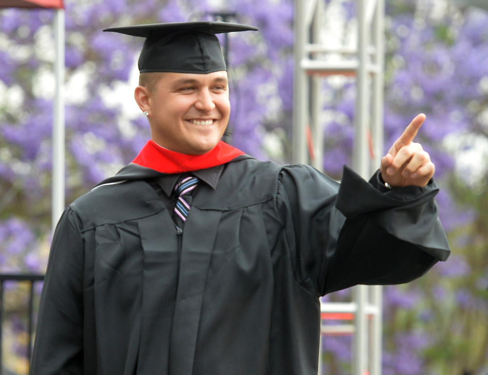 . David Hefner point to family during the Commencement Ceremony at Biola University in La Mirada on Friday May 23, 2014. Kay Warren, International speaker and author, gives the commencement address. (Photo by Keith Durflinger/Whittier Daily News)