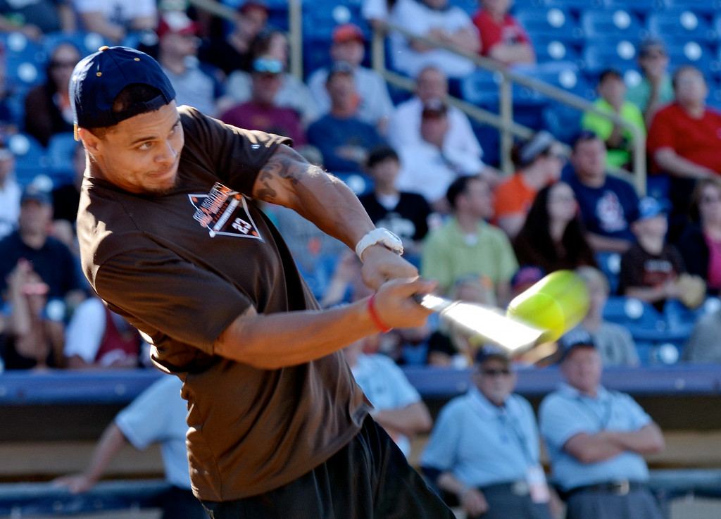 . Jeff Forman/JForman@News-Herald.com Jordan Poyer connects during the home run derby before  the Joe Haden and Friends Softball Game July 17 at Classic Park.