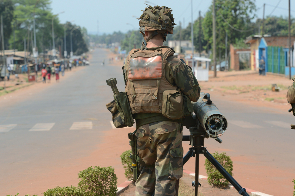 . A French soldier of the Sangaris operation stand next to a mortar during a patrol in Bangui on January 30, 2014. Unrest continues in the Central African Republic despite the efforts of African and French peacekeepers, who are awaiting reinforcements from a European force. Sporadic gunfire, loud explosions and street murders shook the country on January 29, and a diplomat told AFP that French forces had on January 28 killed around 10 fighters from the mainly Muslim Seleka group. The UN Security Council on January 28 gave European troops backing to use force in Central African Republic amid a new international push to end deadly chaos in the country. (AFP PHOTO/ ISSOUF SANOGOISSOUF SANOGO/AFP/Getty Images)