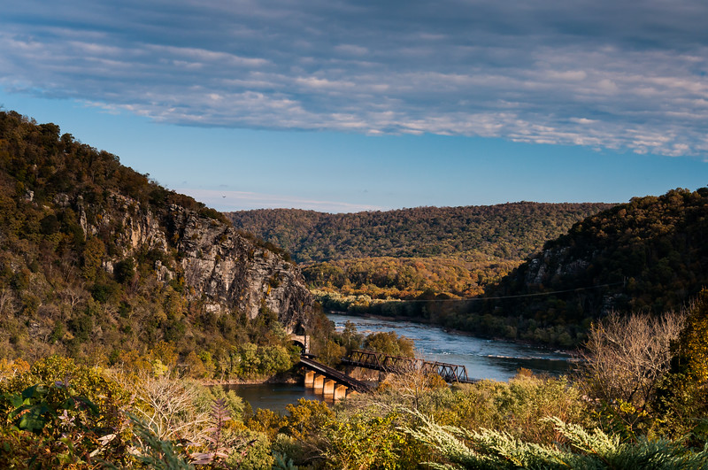 View of Harpers Ferry train bridges and Maryland Heights on a beautiful fall day 2018