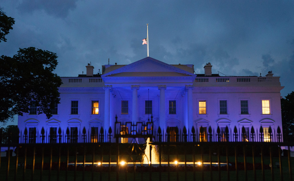 . Blue lights illuminate the White House, Tuesday, May 15, 2018, in Washington, in honor of Peace Officers Memorial Day. (AP Photo/Carolyn Kaster)