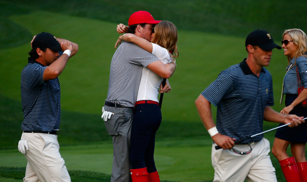 . DUBLIN, OH - OCTOBER 04:  Keegan Bradley of the U.S. Team hugs his girlfriend Jillian Stacey on the 15th green after the team of Mickelson/Bradley defeated the Day/DeLaet team 4&3 during the Day Two Foursome Matches at the Muirfield Village Golf Club on October 4, 2013  in Dublin, Ohio.  (Photo by Gregory Shamus/Getty Images)