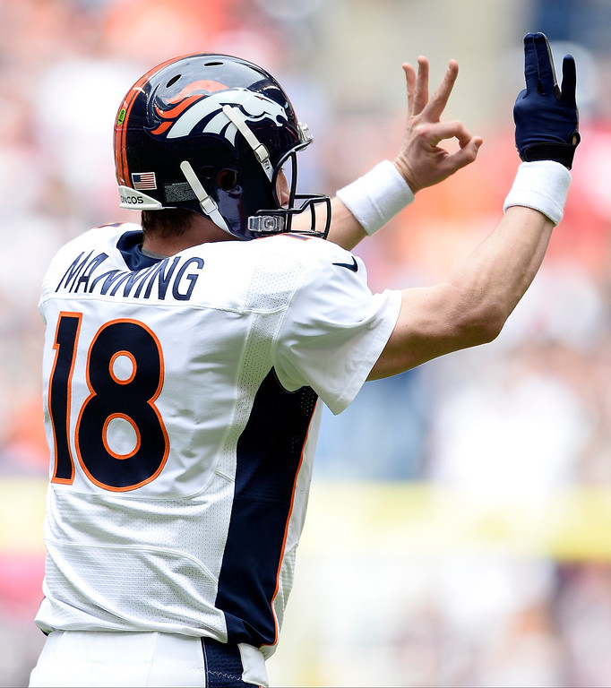 . Denver Broncos quarterback Peyton Manning (18) signals t the receivers during the first quarter against the Houston Texans December 22, 2013 at Reliant Stadium. (Photo by John Leyba/The Denver Post)