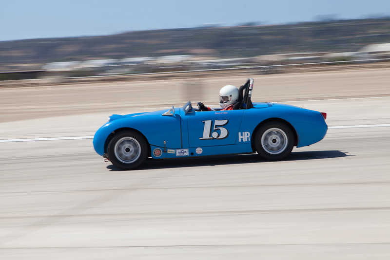 Dewey deButts going into turn 10 in his 1960 Austin Healey Sprite. © 2014 Victor Varela