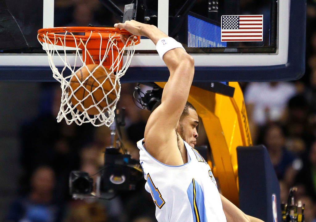 . Denver Nuggets\' JaVale McGee dunks behind his back over the Oklahoma City Thunder in their NBA basketball game in Denver March 1, 2013. REUTERS/Rick Wilking