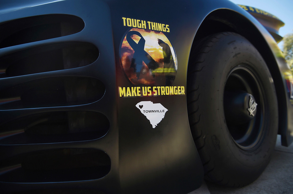 . A sticker remember the Townville Elementary School shooting is affixed to the Heroes 4 Higher Batmobile during a superhero-themed funeral service for Jacob Hall at Oakdale Baptist Church on Wednesday, Oct. 5, 2016, in Townville, S.C.  Jacob\'s family has encouraged people to celebrate his life by dressing as the superheroes he loved.  A 14-year-old boy killed his own father, then drove to Townville Elementary and fired on two children and a teacher as recess began.  Jacob died Saturday.  (AP Photo/Rainier Ehrhardt)