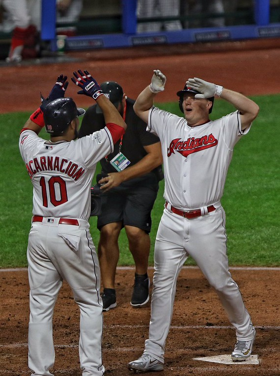 . Tim Phillis - The News-Herald Jay Bruce celebrates with Edwin Encarnacion after hitting a home run during Game 1 of the American League Division Series against the Yankees on Oct. 5 at Progressive Field.