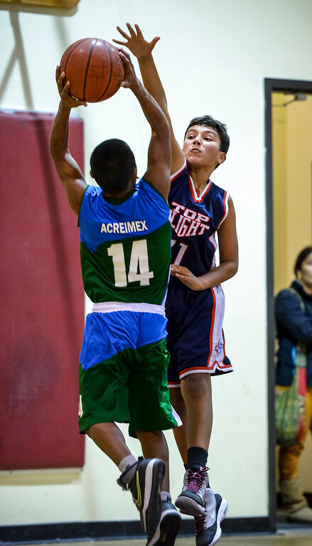 """. Triqui kids basketball team, from the mountainous region of Oaxaca, Mexico, who have been called the \""""Barefoot Champions of the Mountain,\"""" are known throughout their native Mexico for playing basketball without shoes took on the local Top Flight boys team at the Pacific Boys Lodge in Woodland Hills, CA Wednesday, December 18, 2013.  The Triqui team defeated Top Flight 31-29.  (Photo by David Crane/Los Angeles Daily News)"""