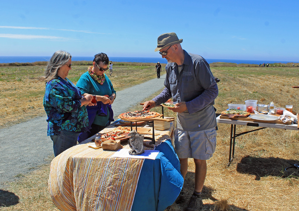 . Steven Duerr, proprietor of Piaci Pub and Pizzeria, offered his wares in the sunshine.