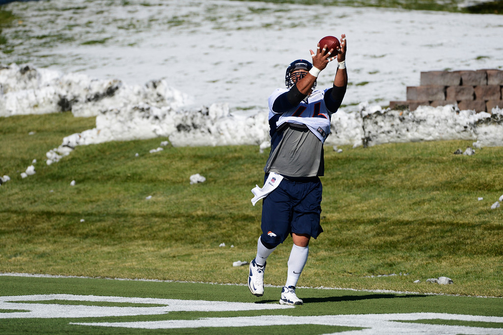 . Denver Broncos Center, Manny Ramirez,  catches a pass during practice Friday morning, October 18, 2103.  (Photo By Andy Cross/The Denver Post)