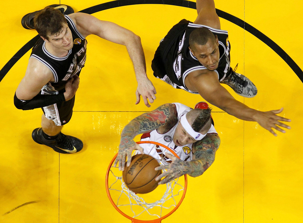 . Miami Heat power forward Chris Andersen (C) dunks on San Antonio Spurs center Boris Diaw (R) during the first half of Game 2 during their NBA Finals basketball playoff in Miami, Florida June 9, 2013.  REUTERS/Mike Segar