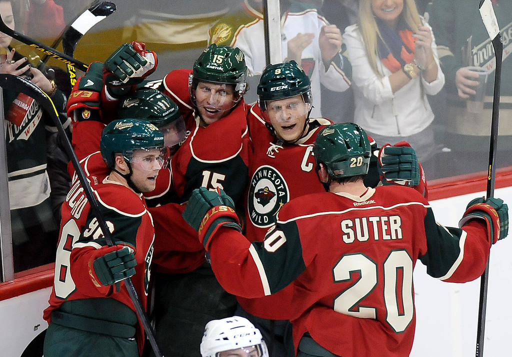 . Minnesota Wild\'s Dany Heatly (15), center, is surrounded by teammates, from left, Pierre-Marc Bouchard (96), Zach Parise (11}, Mikko Koivu (9) and Ryan Suter (20) as they celebrate his second period goal against the Colorado Avalanche during an NHL hockey game in St. Paul, Minn. on Saturday, Jan. 19, 2013. (AP Photo/ St. Paul Pioneer Press, Sherri LaRose-Chiglo)