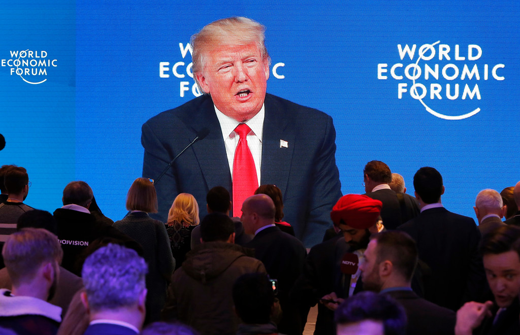 . U.S. President Donald Trump\'s speech is displayed on a video screen during the annual meeting of the World Economic Forum in Davos, Switzerland, Friday, Jan. 26, 2018. (AP Photo/Michael Probst)