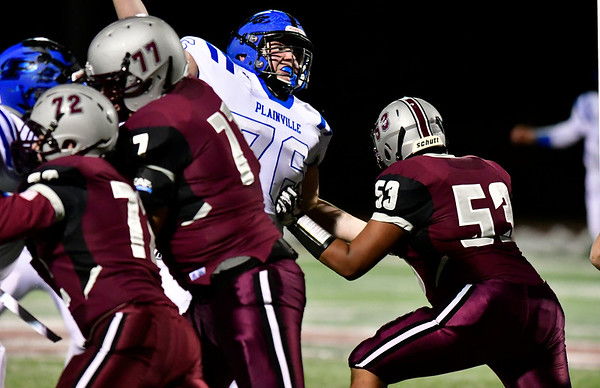 11/21/2018 Mike Orazzi | Staff Plainville's Mike McGinley (76) during Wednesday night's football game with Farmington at Farmington High School.