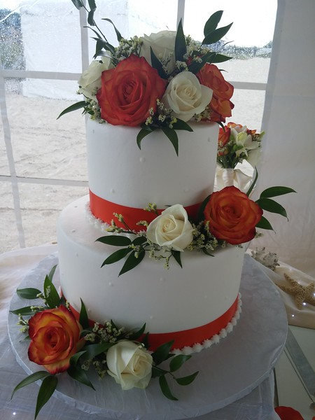 "BOB 8 Another example of a cost effective pro quality cake.  Bride to supply fresh flowers and fabric ribbon to.  This one is a two tier 9/6"" serving 44"