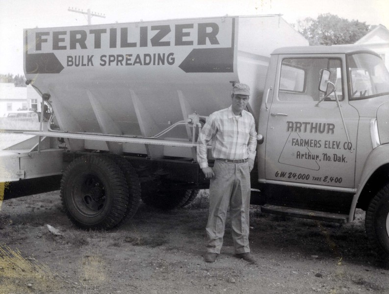 ARE027.  Don Holm‡ with Farmers Elevator new fertilizer truc.jpg