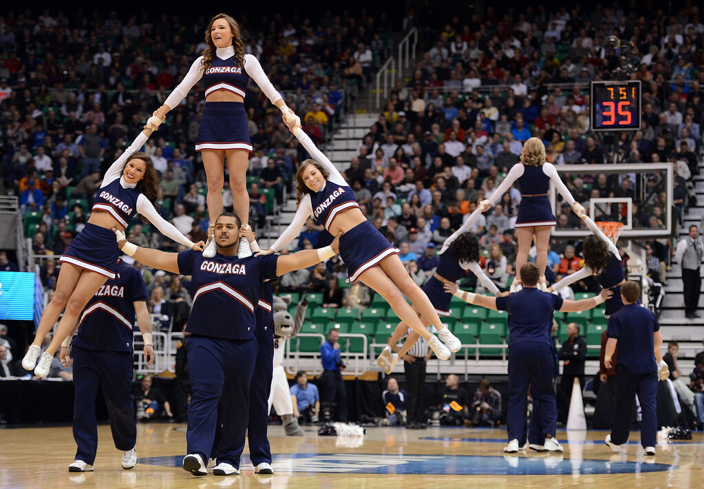 . SALT LAKE CITY, UT - MARCH 21:  The Gonzaga Bulldogs cheerleaders perform in the first half during a break in the game against the Southern University Jaguars during the second round of the 2013 NCAA Men\'s Basketball Tournament at EnergySolutions Arena on March 21, 2013 in Salt Lake City, Utah.  (Photo by Harry How/Getty Images)