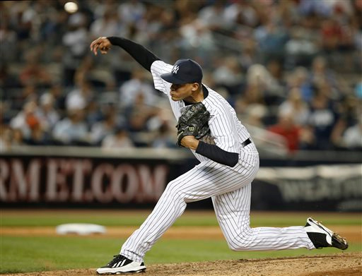 . New York Yankees relief pitcher Dellin Betances delivers in the eighth inning of a baseball game against the Detroit Tigers at Yankee Stadium in New York, Tuesday, Aug. 5, 2014. (AP Photo/Kathy Willens)