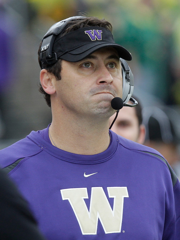. Washington head coach Steve Sarkisian looks at the score board in the first half of an NCAA college football game against Oregon Saturday, Nov. 6, 2010, in Eugene, Ore. Oregon defeated Washington 53-16.(AP Photo/Rick Bowmer)