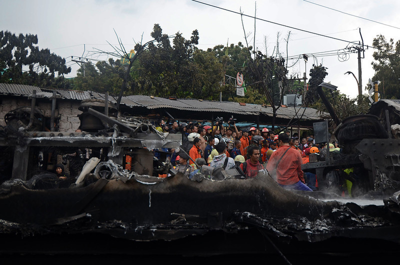 . Rescue workers inspect the train wreck on December 9, 2013 on the outskirts Jakarta, Indonesia. A commuter train collided with a vehicle reportedly carrying liquefied gas canisters at around 11:20am local time. At least five people are reported dead.  (Photo by Nurcholis Anhari Lubis/Getty Images)