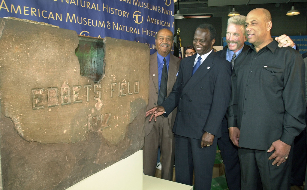 """. Baseball Hall of Famers, from left, Larry Doby, Lou Brock, Mike Schmidt and Orlando Cepeda check out a cornerstone from Ebbets Field during an event announcing \""""Baseball As America,\"""" the first major exhibition exploring baseball and American culture, Thursday, Nov. 8, 2001, at the American Museum of Natural History in New York.  The exhibit, organized by the National Baseball Hall of Fame and Museum,  premieres March 16, 2002, at the Natural History Museum. (AP Photo/Kathy Willens)"""