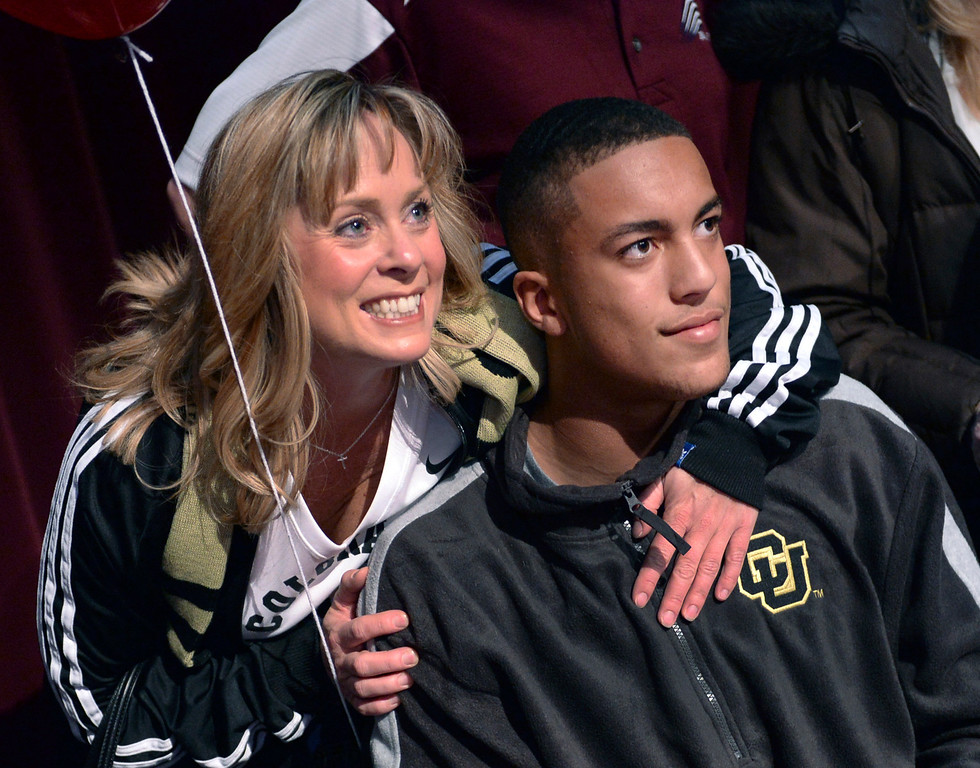 . AURORA, CO. - FEBRUARY 4: Cherokee Trail senior Evan White posed for photographs with his mother Cindy at the conclusion to a ceremony at school Wednesday. White, who played safety at CT, committed to play football at the University of Colorado. Cherokee Trail honored dozens of athletes on National Signing Day as seniors made final commitments to colleges in return for athletic scholarships Wednesday afternoon, February 5, 2014. Photo By Karl Gehring/The Denver Post
