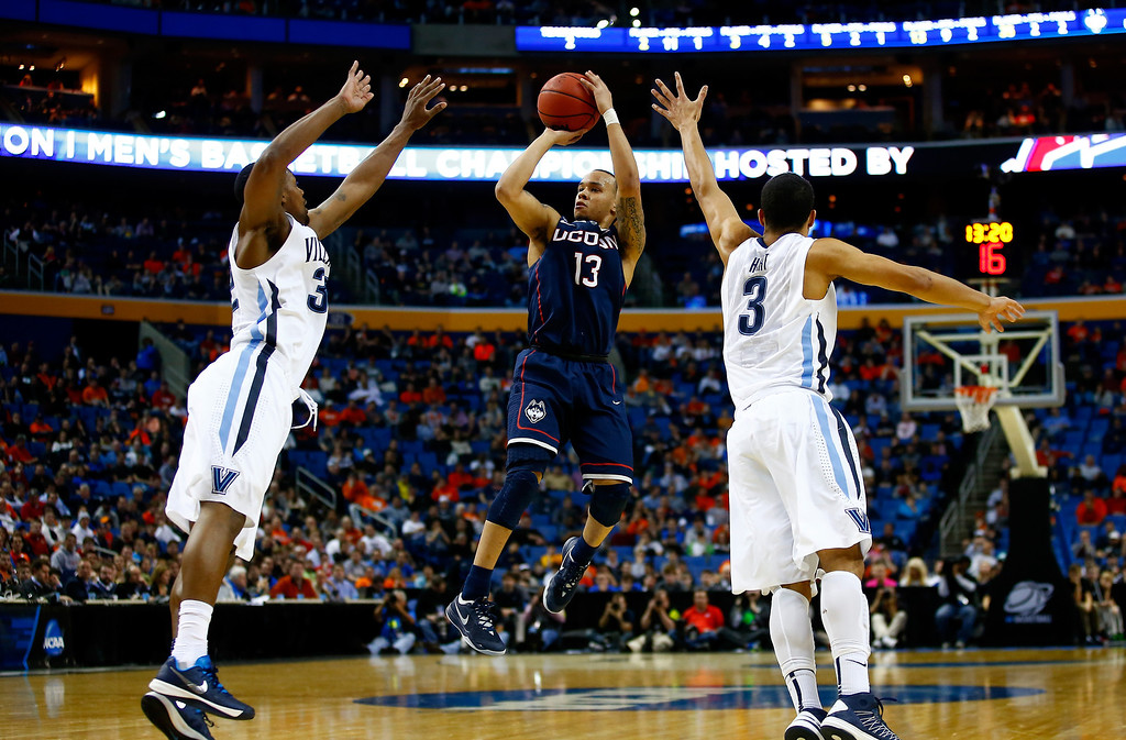 . BUFFALO, NY - MARCH 22: Shabazz Napier #13 of the Connecticut Huskies takes a shot as James Bell #32 and Josh Hart #3 of the Villanova Wildcats defend during the third round of the 2014 NCAA Men\'s Basketball Tournament at the First Niagara Center on March 22, 2014 in Buffalo, New York.  (Photo by Jared Wickerham/Getty Images)