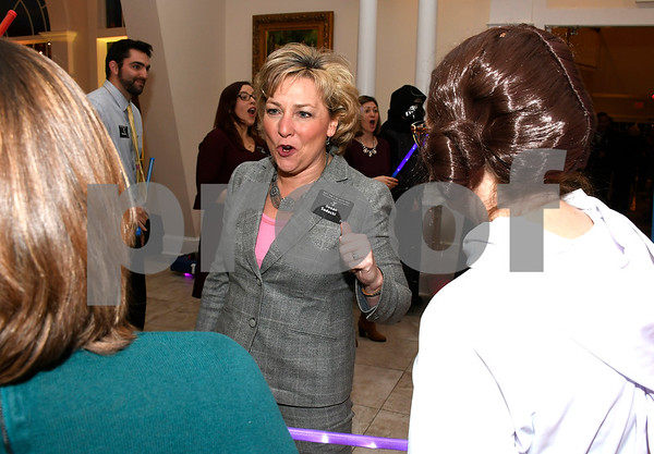2/6/2018 Mike Orazzi | Staff Susan Sadecki arrives during the Southington YMCA's 89th Annual Meeting &quote;May the Y Be With You&quote; held at the Aqua Turf Club in Southington Tuesday night.