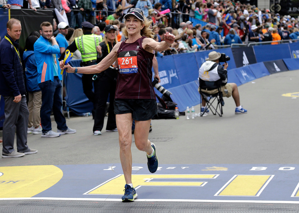 . Kathrine Switzer, who was the first official woman entrant in the Boston Marathon 50 years ago, crosses the finish line in the Boston Marathon, Monday, April 17, 2017, in Boston. (AP Photo/Elise Amendola)