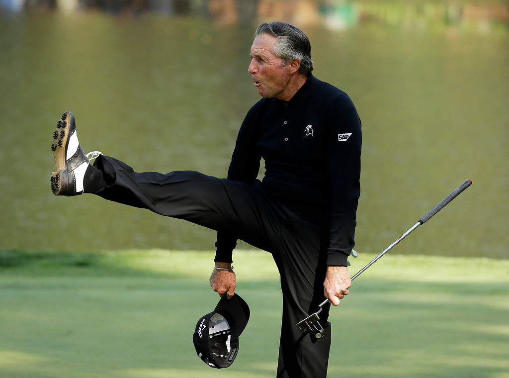 . Gary Player kicks the air after a birdie putt on the ninth hole during the par three competition at the Masters golf tournament Wednesday, April 9, 2014, in Augusta, Ga. (AP Photo/Chris Carlson)