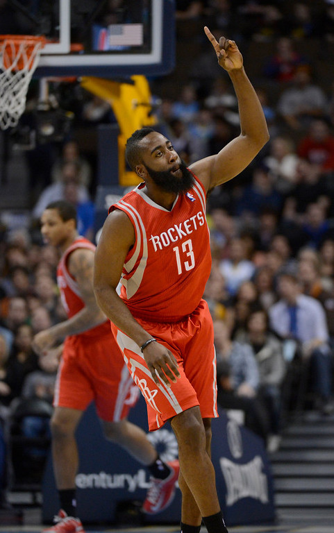 . DENVER, CO. - JANUARY 30: Houston Rockets shooting guard James Harden (13) points to up after hitting a three pointer against the Denver Nuggets  during the first quarter January 30, 2013 at Pepsi Center. The Denver Nuggets take on the Houston Rockets in NBA action. (Photo By John Leyba/The Denver Post)