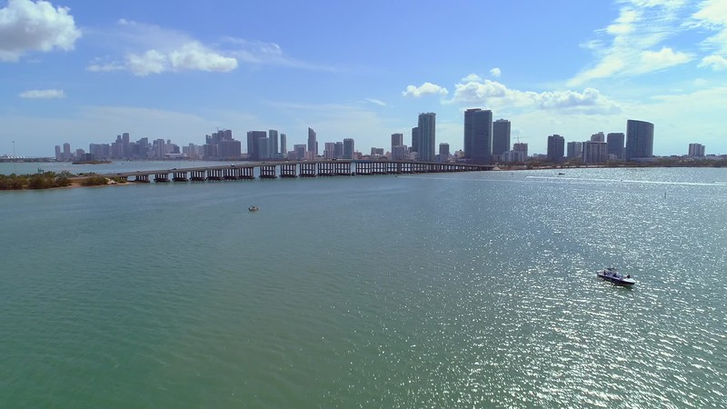 Aerial video Downtown Miami city on the bay and bridges