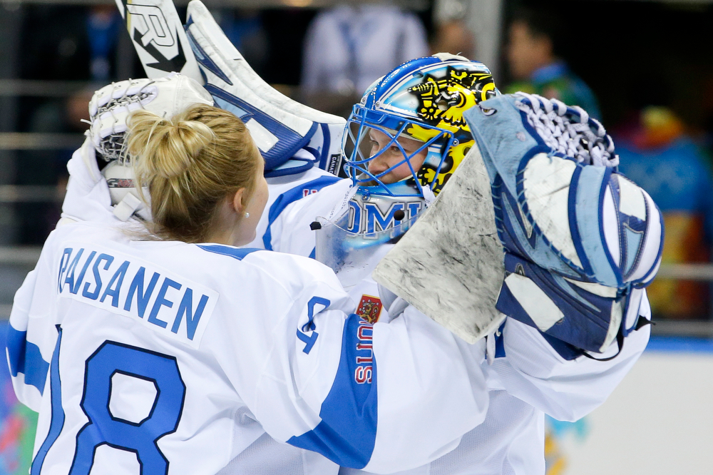 . Goalkeeper Meeri Raisanen (18) hugs goalkeeper Noora Raty of Finland after the 2014 Winter Olympics women\'s ice hockey game against Russia at Shayba Arena, Tuesday, Feb. 18, 2014, in Sochi, Russia. Finland defeated Russia 4-0. (AP Photo/Matt Slocum)