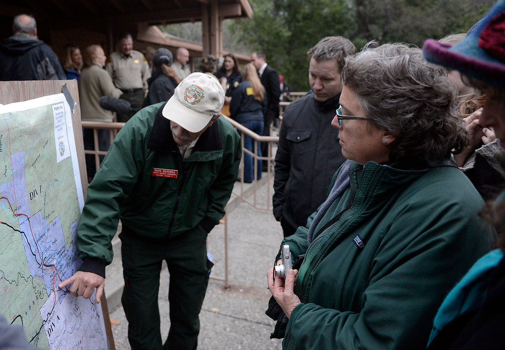 . Dana D\'Andrea U.S. Forest Service deputy incident commander points out features of the fire to residents during the community meeting at the Big Sur Station in Big Sur, Calif. on Wednesday December 18, 2013. (Photo David Royal/ Monterey County Herald)
