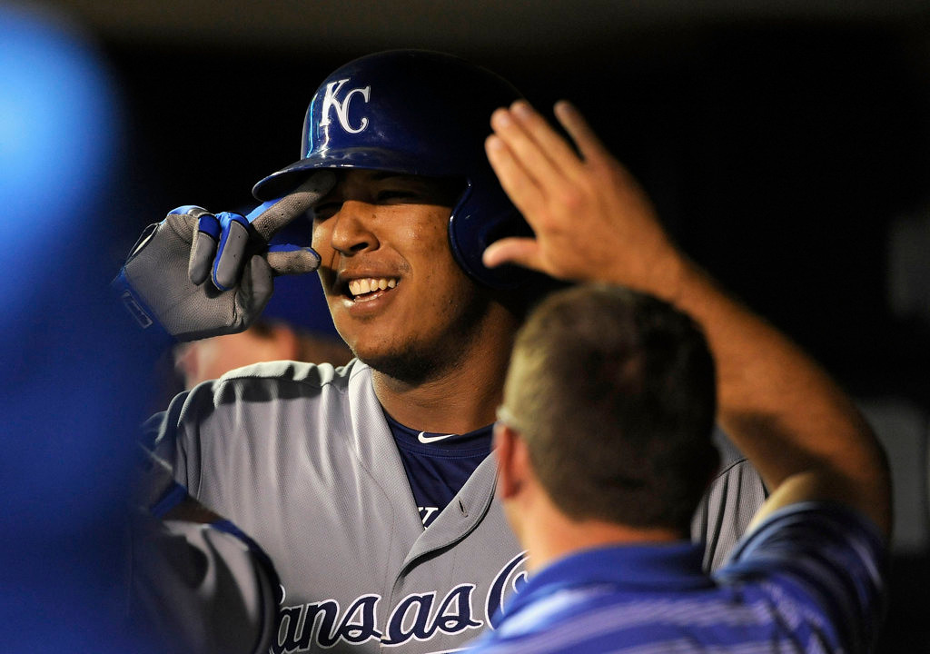 . Salvador Perez #13 of the Kansas City Royals celebrates a two run home run against the Minnesota Twins during the eighth inning of the game on August 28, 2013 at Target Field in Minneapolis, Minnesota. Photo by Hannah Foslien/Getty Images)