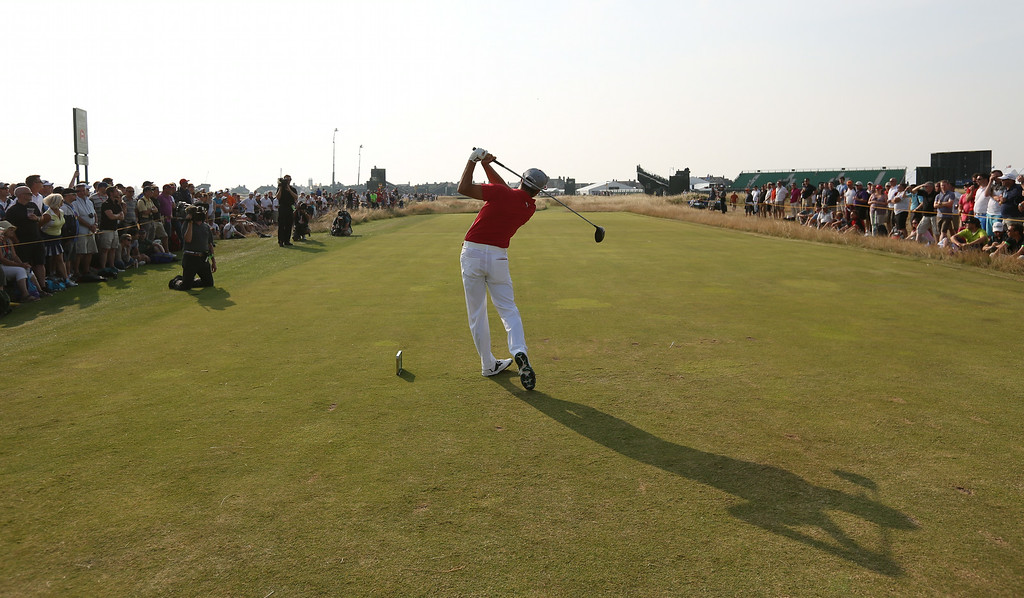 . Rickie Fowler of the US plays a shot off the 17th tee during the second day of the British Open Golf championship at the Royal Liverpool golf club, Hoylake, England, Friday July 18, 2014. (AP Photo/Jon Super)
